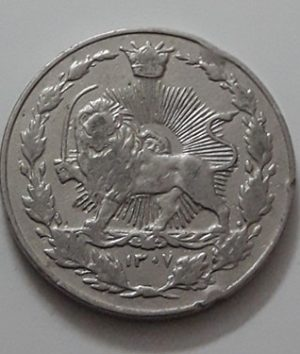 Iranian coin 100 dinars common in the country of Reza Shah Saa 1307 hh