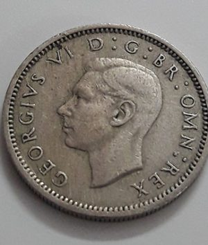 Foreign currency 6 pence British King George VI in 1949-xxp