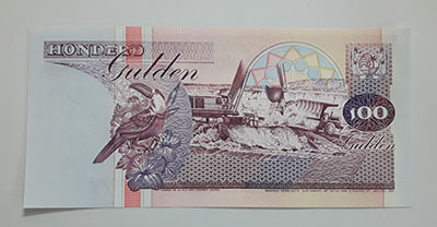 Foreign banknote of the beautiful design of Suriname-dyy