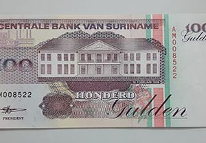 Foreign banknote of the beautiful design of Suriname-dyd