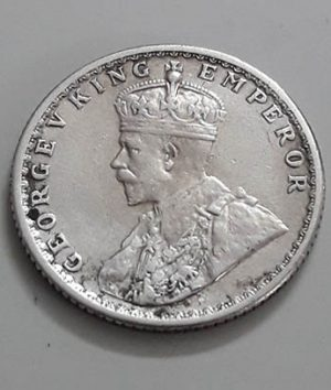 A quarter silver coin of the British Indian colony of King George V dfr