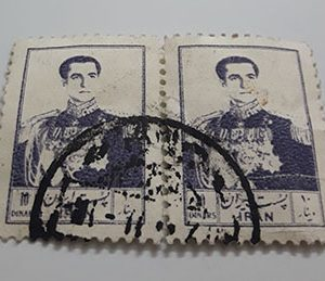 Collectible Iranian stamp of the fifth postal series of 10 dinars (purple)-ate
