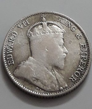 Collectible 10 cent silver silver coin of the British colony of King Edward VII in 1910-aph
