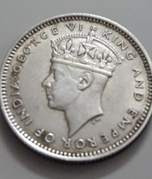 Collectible 10 cent silver silver coin of the British colony of King George VI in 1941-apk