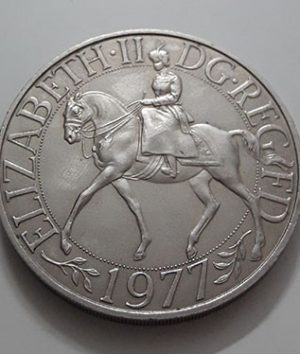 Collectible foreign coin commemorating the coronation of Queen Elizabeth of Great Britain in 1977-taq